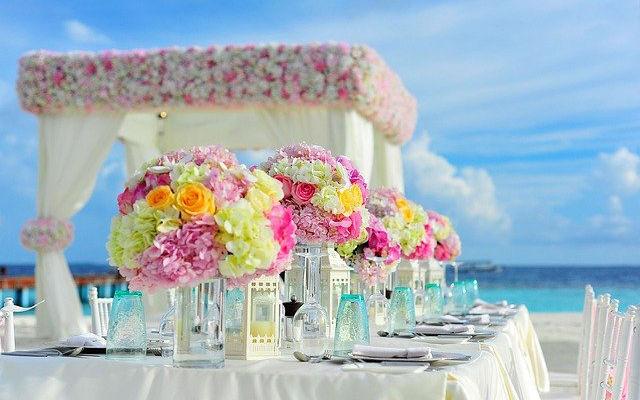 A wedding reception set up on a tropical beach