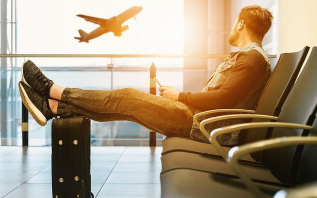 A male traveler waiting in an airport